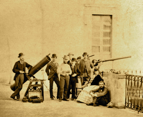 Solar eclipse observers, 1870. Astronomers using telescopes to observe the total solar eclipse from Syracuse, Sicily, on 22nd December 1870.